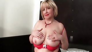 Sexy mature flashing her shaved cunt and boobs