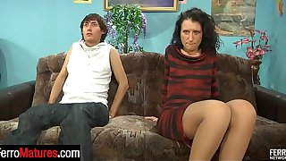 Fiery mature stepmom giving a stepson encouraging kisses for the start of hot fuck