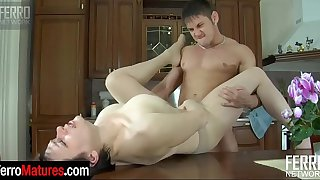 Lusty milf in sheer-to-waist pantyhose chooses a kitchen for fucking games